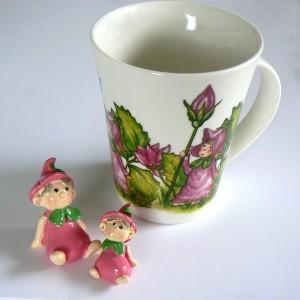 2 Blumenkinder und Blütentasse rosa