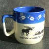 Kaffeebecher / Teebecher Elchspur blau mit Elch und Tor zu Lappland
