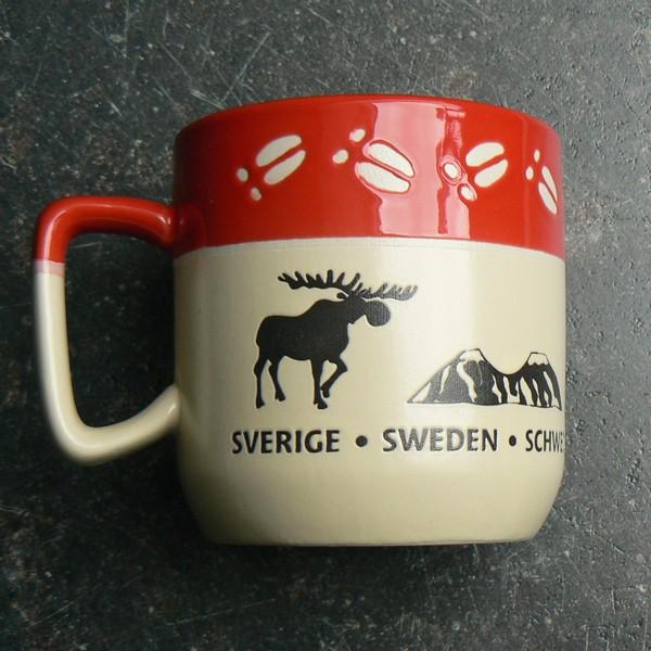 Kaffeebecher / Teebecher Elchspur rot mit Elch und Tor zu Lappland